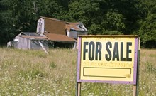 Farm with a 'for sale' sign