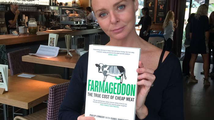 Stella McCartney holds a copy of Farmageddon