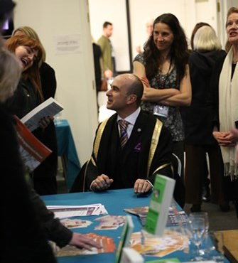 philip signing books.jpg
